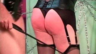 Sexy Dominatrix in Lingerie and Stockings Used Her Crop to Spank a Boy